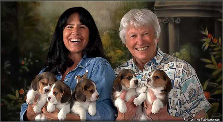 Linda and Sandi with puppies